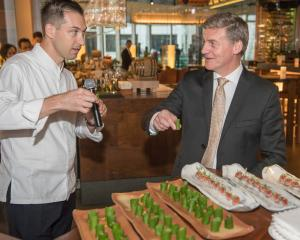 Chef Samuel Wilkes and Prime Minister Bill English at the launch of Te Mana Lamb in Hong Kong....