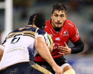 The Lions' Harold Vorster runs the ball at the Brumbies defence. Photo: Getty Images