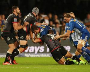 Stormers vice-captain Eben Etzebeth is caught by the Sharks defence. Photo Getty Images
