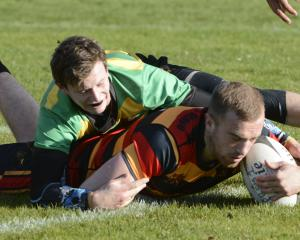 Zingari-Richmond fullback Ciaran Gaffney scores a try during his side's 45-34 win against Green...