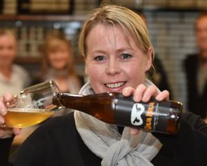 Otago Community Hospice chief executive Ginny Green pours a specially brewed ginger-infused...