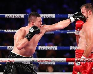 Ten people could face court after streaming the fight which saw Joseph Parker (left) defend his...