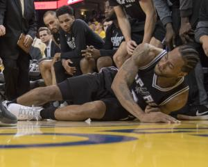 Kawhi Leonard on the floor after aggravating his ankle injury. Photo: Reuters