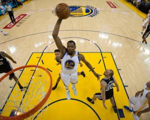 Kevin Durant takes off for a dunk for the Warriors. Photo: Getty Images