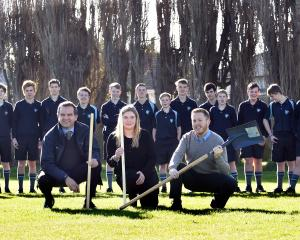 Looking for a spot to drill a 4m-deep hole at King's High School are geography pupils and (from...