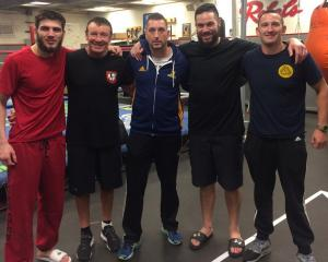 Dunedin boxing coach Ryan Henry (centre) with (from left) undefeated Russian light heavyweight Umar Salamov, boxing coach Kevin Barry, WBO heavyweight champion Joseph Parker and friend Thomas Kaan at UNLV boxing gym in Las Vegas. Photo: Supplied.