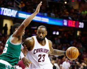 Cavs forward LeBron James drives to the hoop on the way to beating the Boston Celtics in game...