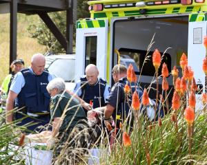 The victim of Shaan Roker's machete attack in Taieri Mouth is carried to an ambulance on February...