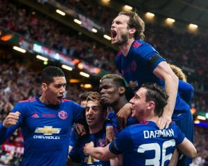 Henrikh Mkhitaryan, Chris Smalling, Matteo Darmian, Juan Mata, and Paul Pogba celebrate...
