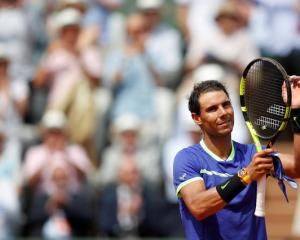 Spain's Rafael Nadal celebrates winning his first round match against France's Benoit Paire at...