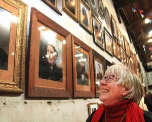 North Otago Early Settlers Association president Helen Stead inspects copies of portraits of...