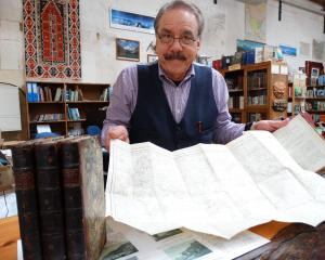 Bill Nye, of Adventure Books, with all four volumes of A Voyage to the Pacific, published...
