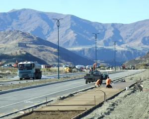 Work proceeds on the first stage of Hawthorne Dr  on Thursday,  at the Remarkables Park end....