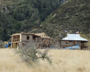 Two wooden houses have been built on a site believed to be one of the locations where the sixth...