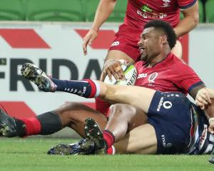 Reds player Samu Kerevi scored the team's final and winning try. Photo: Getty