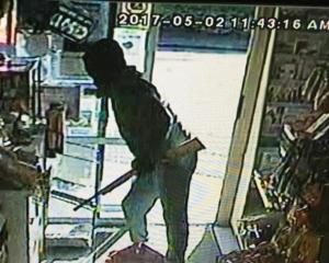 A still from footage of an aggravated robbery at the Halfway Bush Convenience Store in Dunedin...