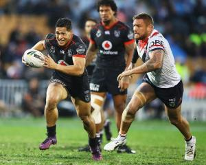 Roger Tuivasa-Sheck makes a break for the Warriors against the Roosters. Photo: Reuters