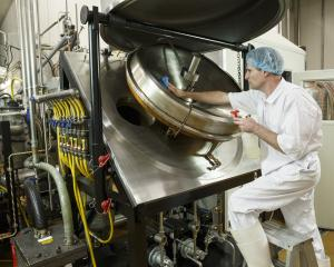 A SeaDragon technician cleans fish oil refining equipment.