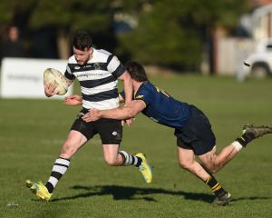 Dunedin winger Guy Woodhouse tackles Southern fullback Bryce Hosie during their game at Bathgate...