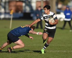 Southern first five-eighth Josh Ioane goes past Dunedin centre Leroy van Dam at Bathgate Park on...