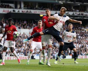 Harry Kane scores the second goal for Spurs against Manchester United. Photo: Getty Images