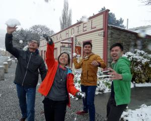 Indonesian tourists (from left) Ade Sumarlin, Vicky Setyawan, Alin, and Hadi Sumarto, have some fun in Cardrona after being turned around before the Crown Range Rd because they did not have chains. Photos: Tim Miller.
