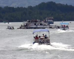 The sinking ferry is seen in this still image taken from video obtained from social media. Louisa...