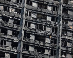 The burnt-out remains of the Grenfell Tower in North Kensington, London. Photo: Reuters