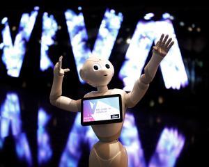 Robots may soon provide financial tips to investors. Photo: Reuters