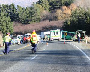 Emergency services attend a crash between a ute and a tourist bus near Roxburgh yesterday. Photo:...