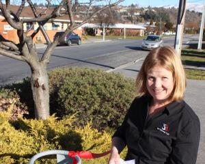 Whitestone Post Central Otago operator Diane Williamson posts a letter at the official opening of the Alexandra franchise. Photo: Jono Edwards