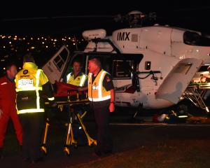 An injured boy arrives by rescue helicopter in Dunedin last night. Photo: Kerrie Waterworth