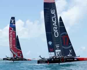 Oracle Team USA skippered by Jimmy Spithill in action racing against Emirates Team New Zealand...