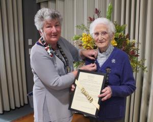 New Zealand Federation of Women's Institute president Kay Hart presents Vi McNutt with her golden honours award for services to the institute on Saturday. Photo: Samuel White