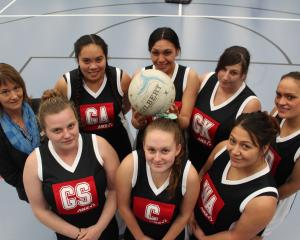 ANZ branch manager Stephanie Duffy with the Nga Whanau o Tokomairiro netball team (clockwise from back left) Te Anna Phillips, Michelle White, Jade Ackland, Keri Mack, Aroha Brich, Alice Melvin and Sammy Butter (front left). Photo: Samuel White