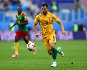 Australia's Bailey Wright with the ball during their game against Cameroon. Photo: Getty Images