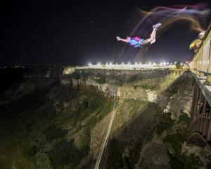 Miles Daisher BASE jumps for 24 hours and sets world record with 63 jumps in Twin Falls, Idaho, USA. Photo: Reuters