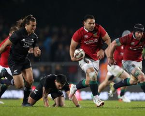 Ben Te'o of the Lions makes a break. Photo: Getty
