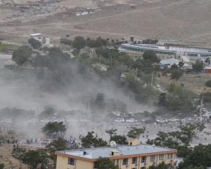 Smoke rises from the site after a blast in Kabul, as conflict continues in the Afghan capital. Photo: Reuters