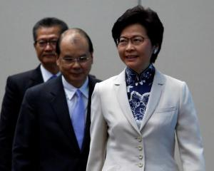 Hong Kong Chief Executive-elect Carrie Lam enters a news conference with Chief Secretary Matthew Cheung and Financial Secretary Paul Chan. Photo: Reuters