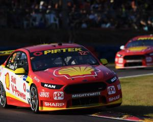 Fabian Coulthard drives the #12 Shell V-Power Racing Team Ford Falcon FGX during race 11 for the...