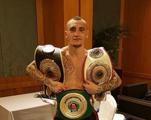 Dunedin boxer Chase Haley poses with his belts after winning the IBO Oceania-Oriental light heavyweight title and two other minor belts in Singapore on the weekend. Photo: Supplied