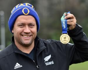 Otago coach Cory Brown shows off the gold medal he collected for his part in New Zealand's successful World Rugby Under-20 Championship campaign. Photo: Peter McIntosh