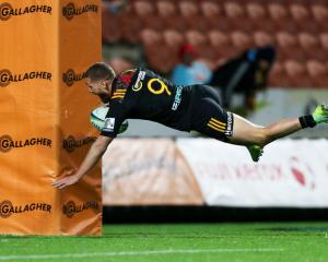Tawera Kerr-Barlow of the Chiefs dives over for a try during the round 15 Super Rugby. Photo: Getty
