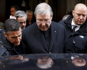 Australian Cardinal George Pell leaves at the end of a meeting with the victims of sex abuse in...