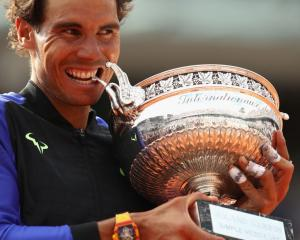Rafael Nadal celebrates with the trophy after his victory. Photo Getty