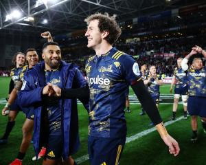 Highlanders Marty Banks (R) and Lima Sopoaga celebrate their team's win over the British and...