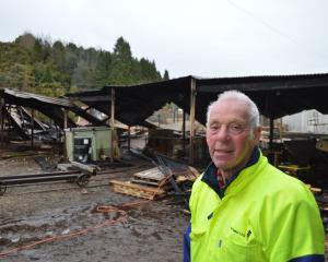 Westimber shareholder Grant Gibson in front of the fire-damaged Ngahere sawmill this morning....