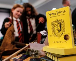 Harry Potter fans attend an anniversary presentation at Waterstones bookshop in London. Photo:...