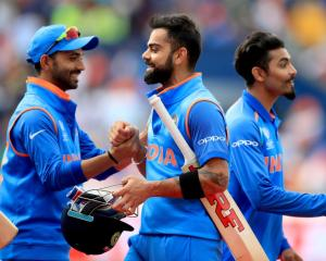 Virat Kohli (centre) celebrates India's win. Photo: Getty Images